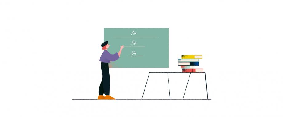 Eine Schülerin steht im Klassenzimmer und schreibt die Buchstaben Ä, Ö und Ü an die Tafel. In diesem Post findest du Unterrichtsmaterialien zum Thema Umlaute.